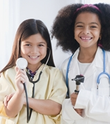 Girls dressed up as doctors